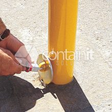Removable bollard with sleeve