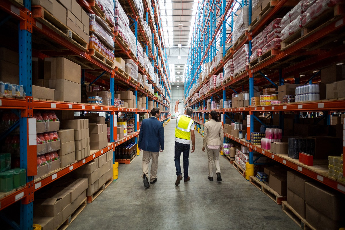 Warehouse being inspected by three employees